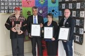 Bob Oshanyk, Minister Sabir, Yvonne Oshanyk, and Rob Mackin With Awards