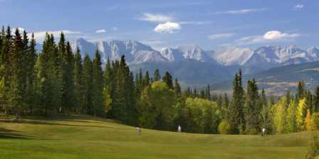 Golf course with the Rocky Mountains in the distance.