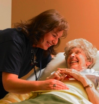 A woman assisting a senior woman.