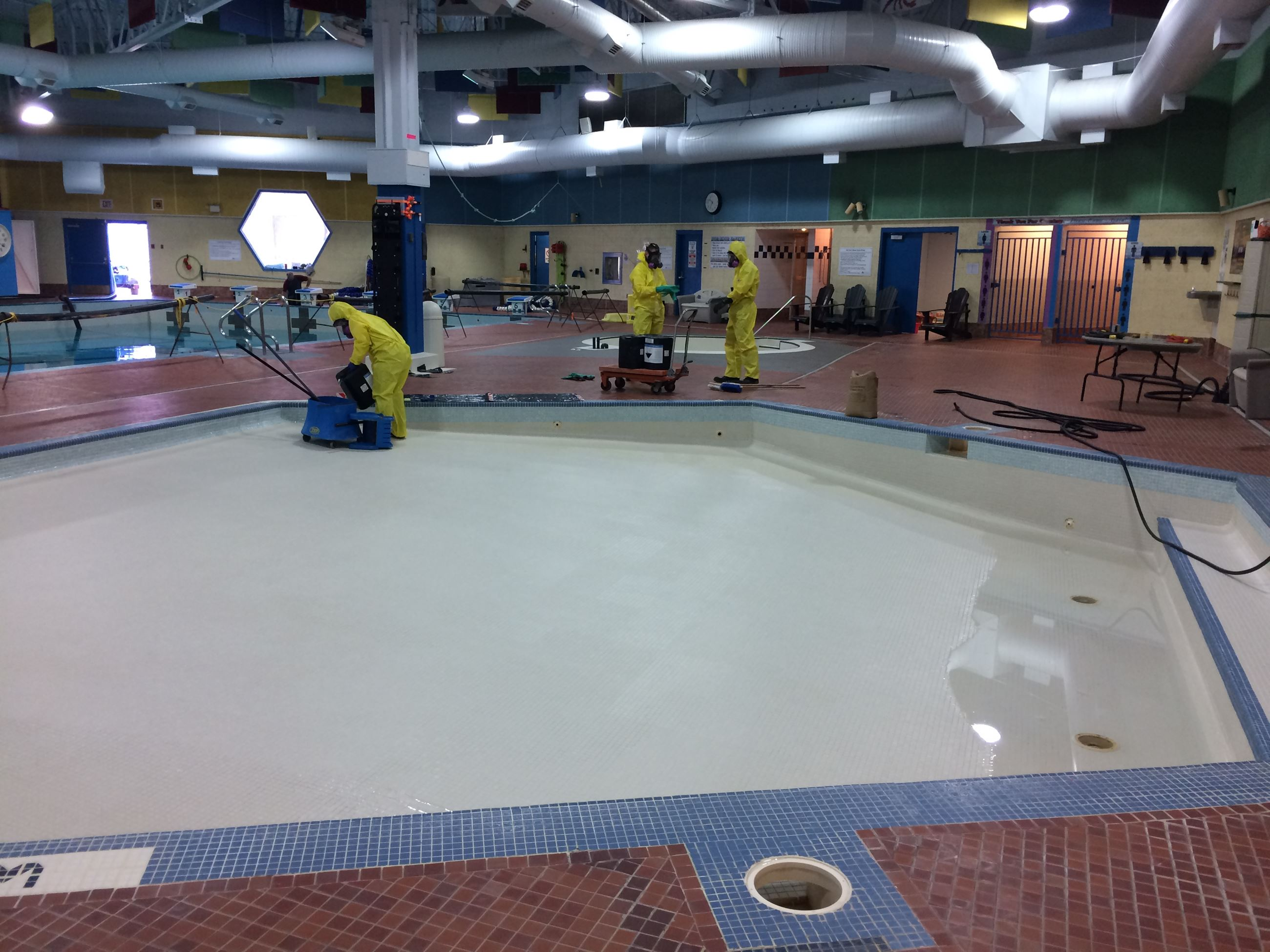 Preparing to acid wash the play pool basin as main pool drains