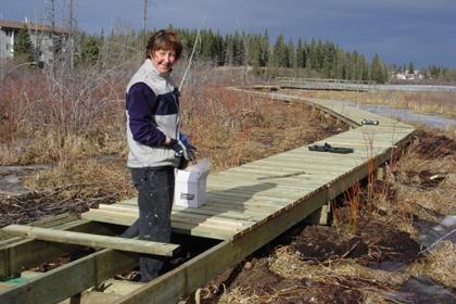 Community volunteer helping build